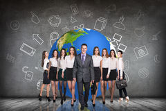 Businesspeople in the gray room and earth behind Stock Photography