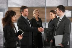 Businesspeople greeting each other stock images