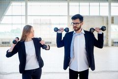 Businesspeople in a gym. A portrait of businesspeople doing sports in a gym royalty free stock images