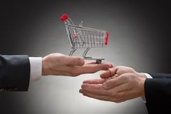 Businesspeople hands with shopping cart royalty free stock images