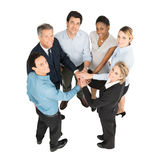 Businesspeople With Hands Stacked Stock Photo