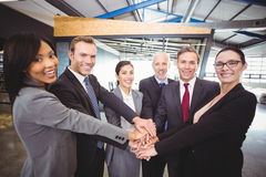 Businesspeople hands stacked over each other. In office Stock Photo