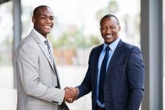 Businesspeople handshaking. Portrait of happy african american businesspeople handshaking Royalty Free Stock Photo