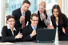 Businesspeople have team meeting in office. Business - businesspeople have team meeting in an office with laptop, it is a very good team stock photography
