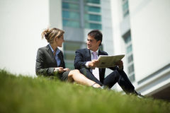 Businesspeople Having Break Outdoors Stock Photo
