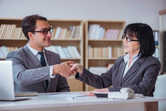 The businesspeople having business discussion in office. Businesspeople having business discussion in office Stock Photos