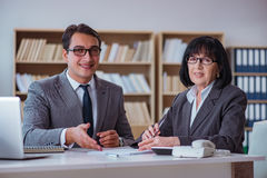 The businesspeople having business discussion in office Stock Photography