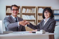 The businesspeople having business discussion in office. Businesspeople having business discussion in office Stock Photography