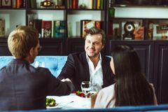 Businesspeople having business lunch Stock Images