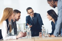 Businesspeople. Having conversation in conference hall stock photo