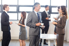 Businesspeople having a discussion during breaktime Royalty Free Stock Photos