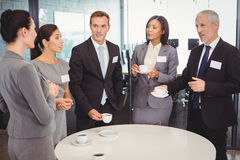 Businesspeople having a discussion during breaktime Stock Image