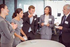 Businesspeople having a discussion during breaktime Royalty Free Stock Images