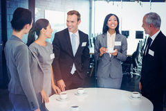 Businesspeople having a discussion during breaktime Royalty Free Stock Image