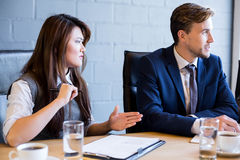 Businesspeople having a discussion in conference room. In office stock photography