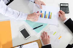Businesspeople having a discussion about financial report. At office stock photography