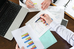 Businesspeople having a discussion about  financial report Royalty Free Stock Photo