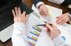 Businesspeople having a discussion about  financial report Royalty Free Stock Images