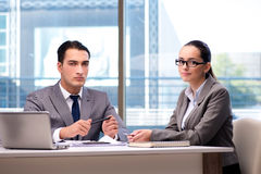 The businesspeople having discussion in the office Stock Image