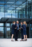 Businesspeople having a discussion in office premises. Businesspeople standing and having a discussion in office premises Royalty Free Stock Photos