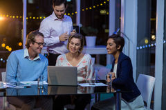 Businesspeople having discussion over laptop Royalty Free Stock Photo