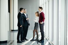 Businesspeople Having Informal Meeting In Modern Office on windows background stock images