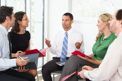 Businesspeople Having Informal Meeting Stock Photo