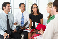 Businesspeople Having Informal Meeting Stock Photography
