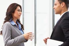 Businesspeople Having Informal Meeting. In Office Royalty Free Stock Image