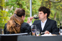 Businesspeople having lunch in restaurant Stock Image