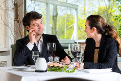 Businesspeople having lunch in restaurant Stock Photo