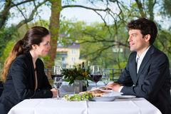 Businesspeople having lunch in restaurant Royalty Free Stock Image