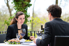 Businesspeople having lunch in restaurant Stock Images