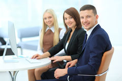 Businesspeople Having Meeting Around Table In Modern Office Royalty Free Stock Images