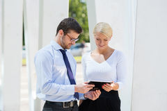 Businesspeople having a meeting outdoors with tablets Stock Photos