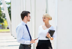 Businesspeople having a meeting outdoors with tablets Royalty Free Stock Photos