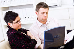 Businesspeople having problem. Troubled businessman and female assistant working on a laptop computer at office Stock Photos
