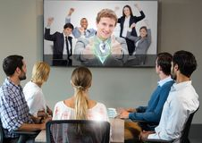 Businesspeople having video calling on television Stock Photo