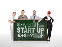 Businesspeople holding blackboard with start up Royalty Free Stock Image