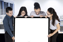 Businesspeople holding blank signboard Stock Image