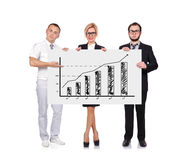Businesspeople holding chart. Businesspeople holding blackboard with chart Stock Images