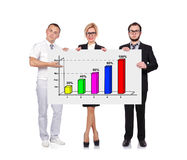 Businesspeople holding chart. Businesspeople holding blackboard with chart Stock Photo