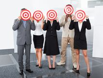 Businesspeople holding dartboard Royalty Free Stock Photos