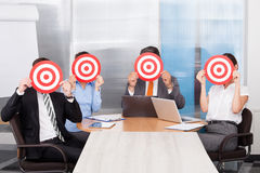 Businesspeople Holding Dartboard Royalty Free Stock Image