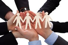 Businesspeople holding human figure cutout Stock Photo