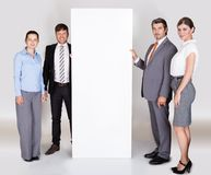 Businesspeople Holding Placard Royalty Free Stock Image