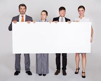 Businesspeople Holding Placard Royalty Free Stock Photo