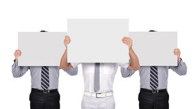 Businesspeople holding poster Stock Photo