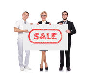 Businesspeople holding sale Stock Photography
