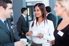 Businesspeople interacting conference. Businesspeople interacting during coffee break at business conference Royalty Free Stock Image